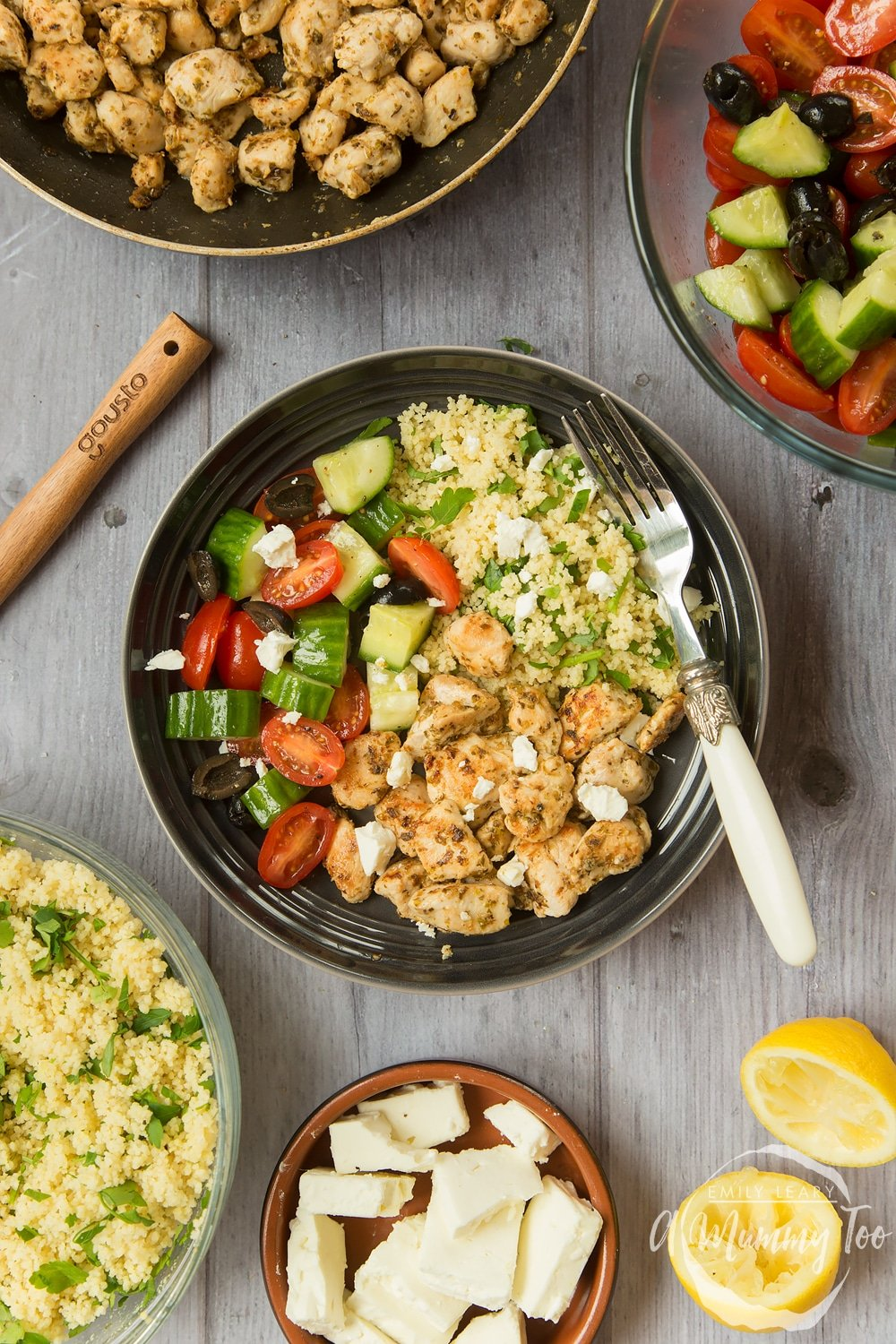 Speedy Greek chicken salad with seasoned chicken, salad and herby couscous