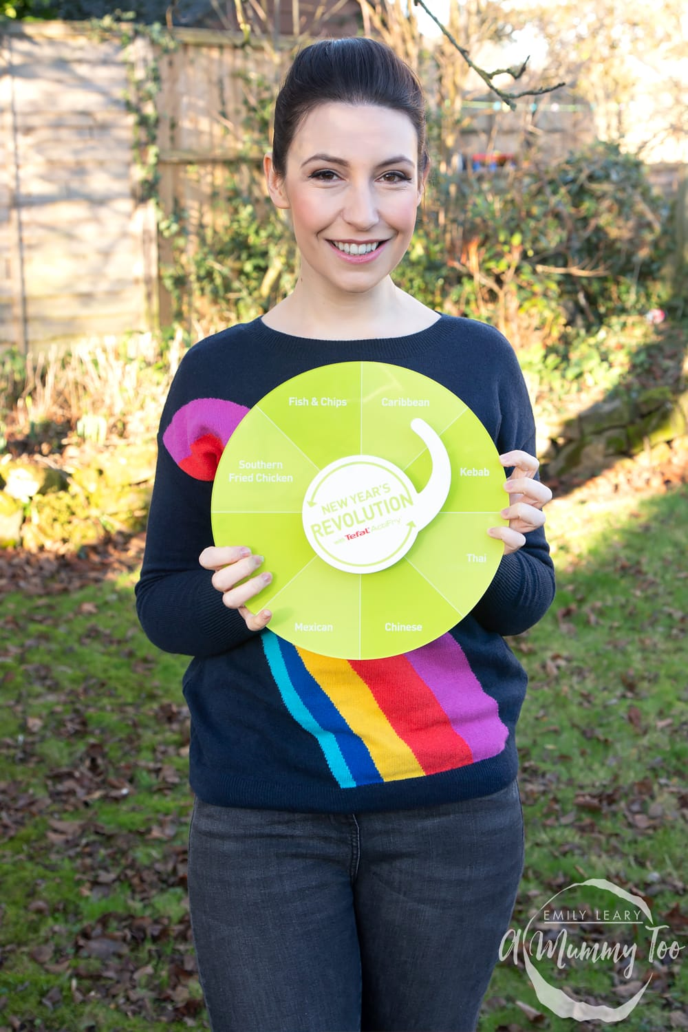 Emily Leary holding a New Year's Resolution wheel