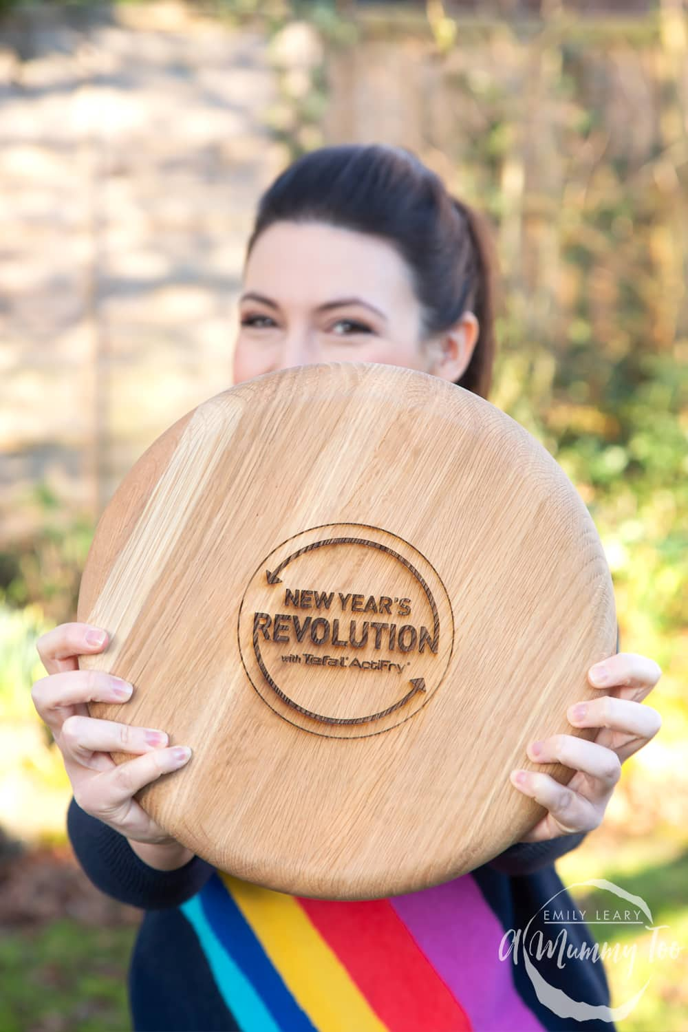 Emily Leary holding a 'New Year's Revolution with Tefal ActiFry' chopping board