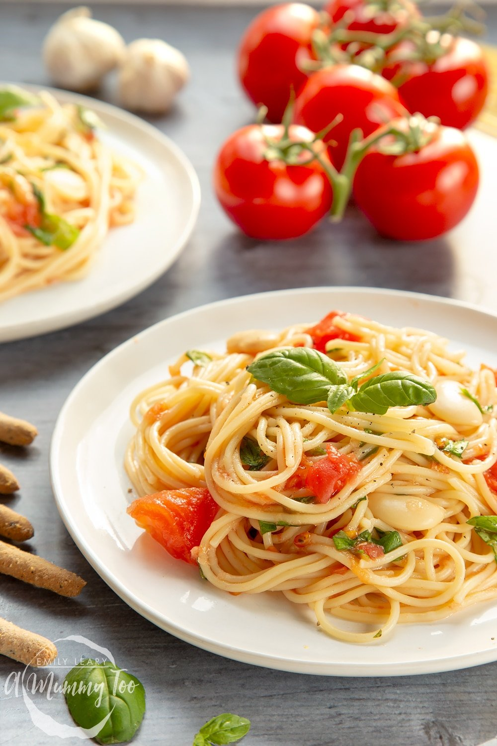 Tomato, bean and garlic spaghetti, served on a plate
