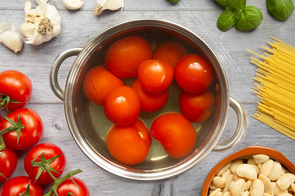 Tomatoes boiling in a saucepan