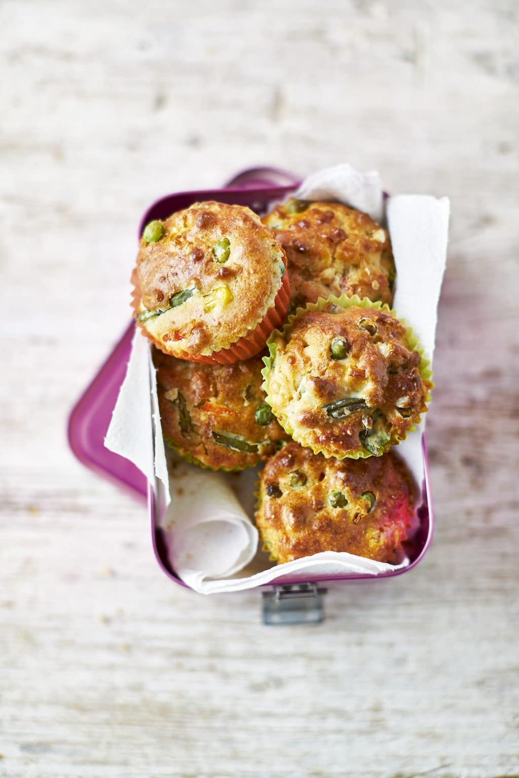 Overhead shot of Savoury Lunchbox Muffins served on a pink lunchbox