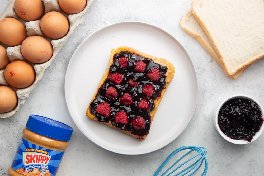 Blueberry jam is added to the French Toast topped with peanut butter