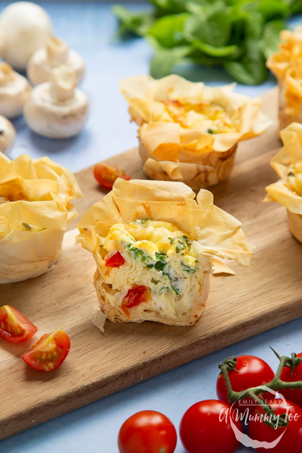 Filo pastry mini quiches - cut open to show the cooked filling.