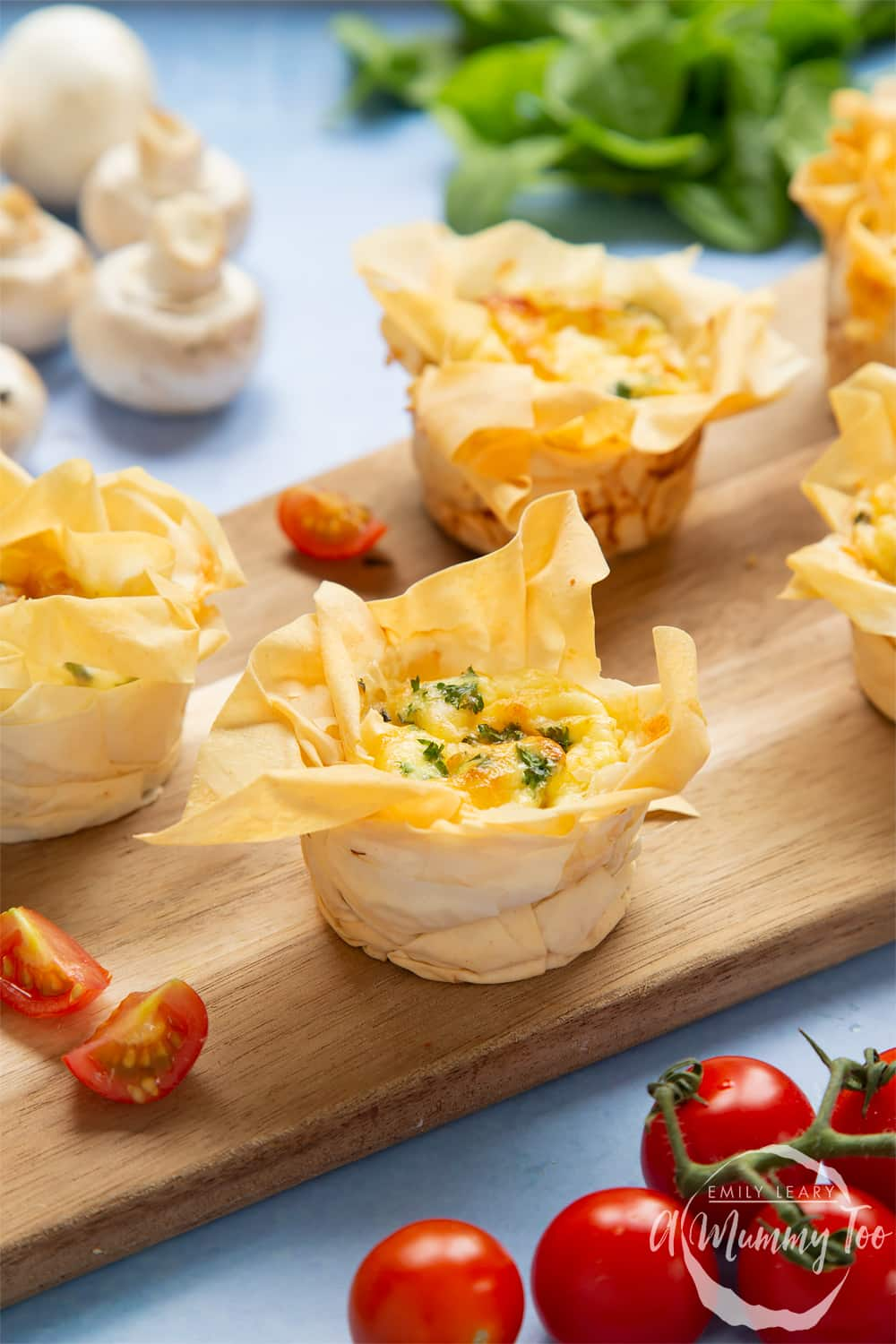 Filo pastry mini quiches - cooked and on board.