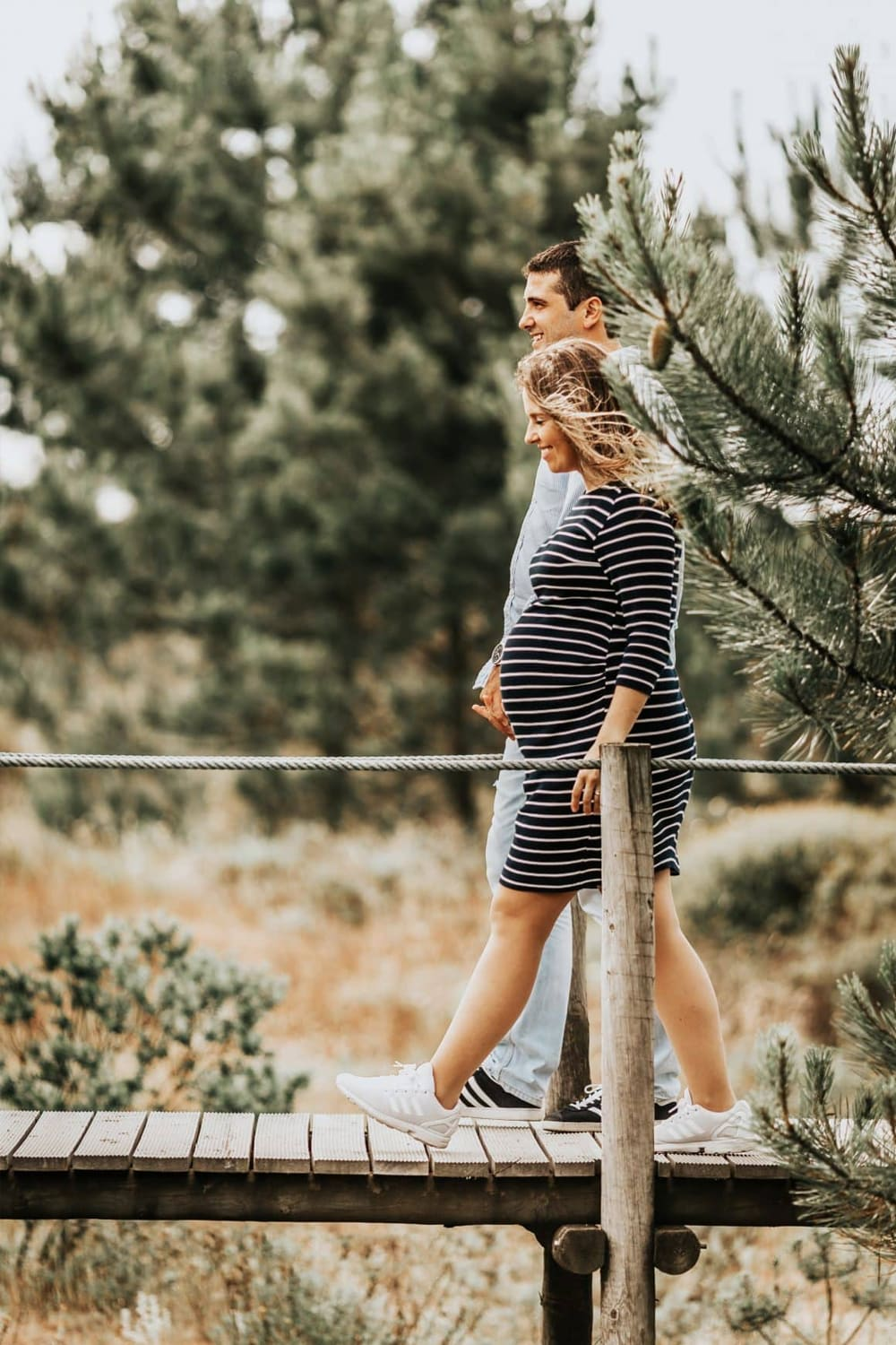 Pregnant woman taking a stroll with her partner