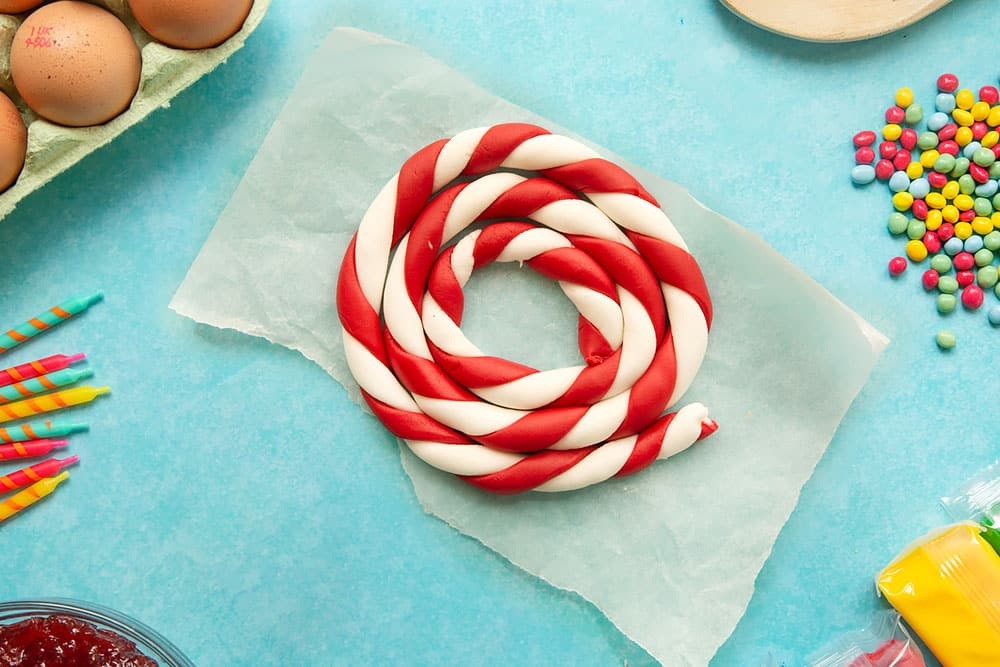 Red and white lengths of sugar paste, twisted together and rolled to form a candy cane stripe