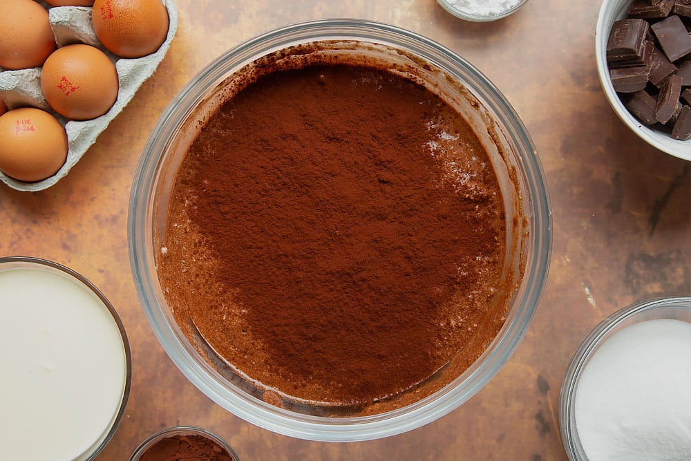 Cocoa added to flourless chocolate sponge batter.