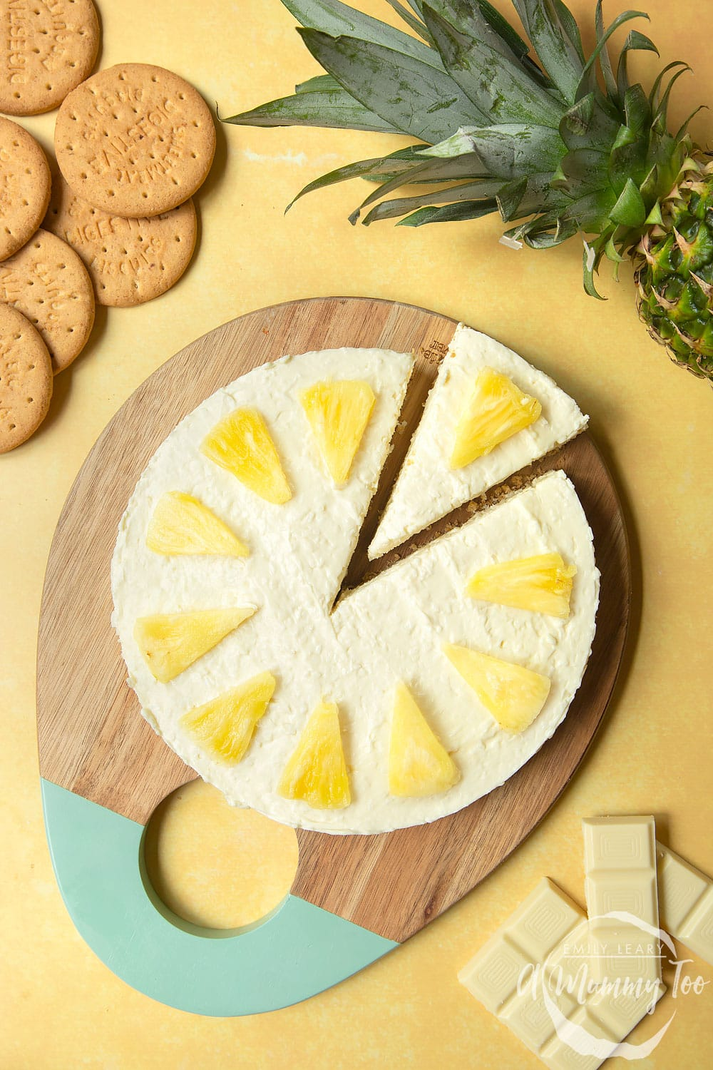 Extra special no-bake coconut cheesecake topped with pineapple pieces.