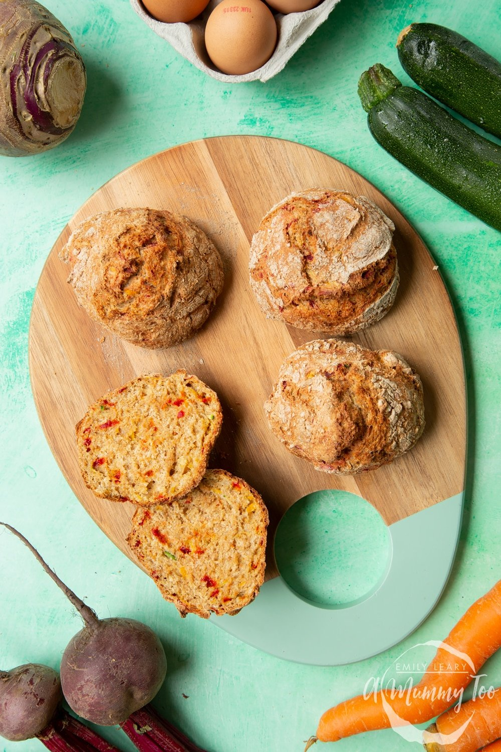 Vegetable soda bread rolls recipe - rolls arranged on a board, one cut open to show the vegetable flecked interior.