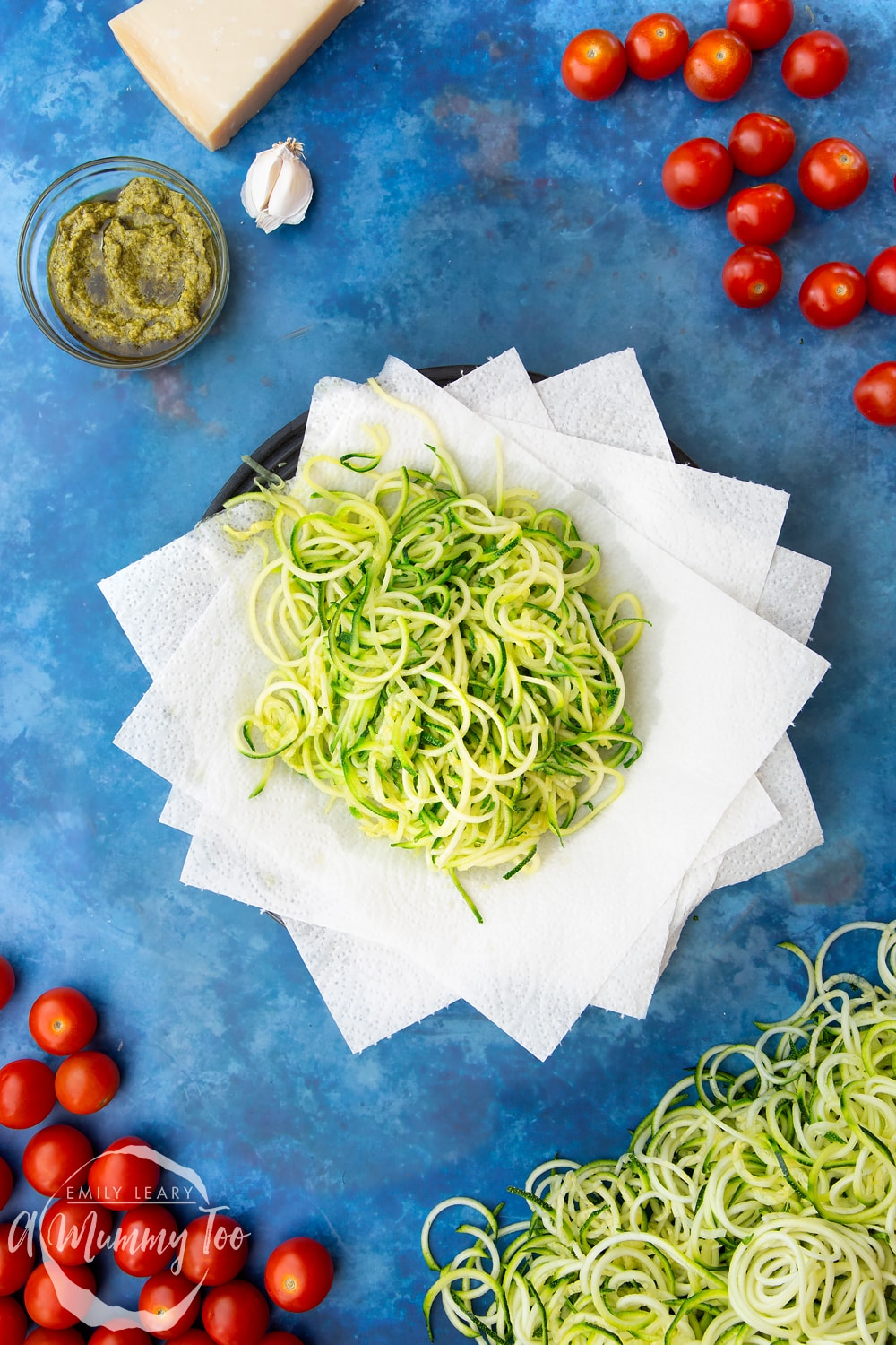 Cooked spiralised courgette on a plate lined with kitchen towel