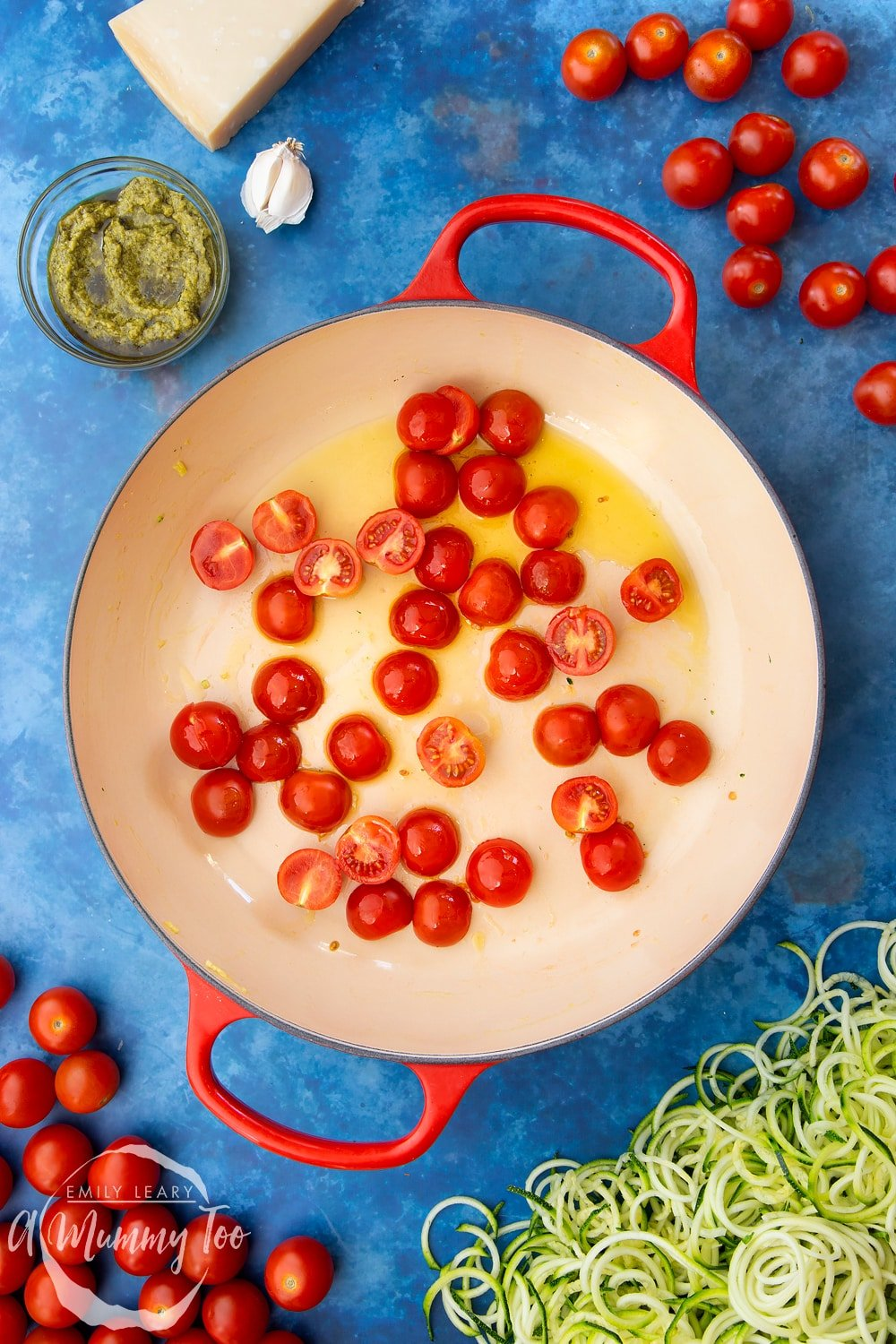 Cherry tomatoes, garlic, olive oil, black pepper and spiralised courgette in a frying pan