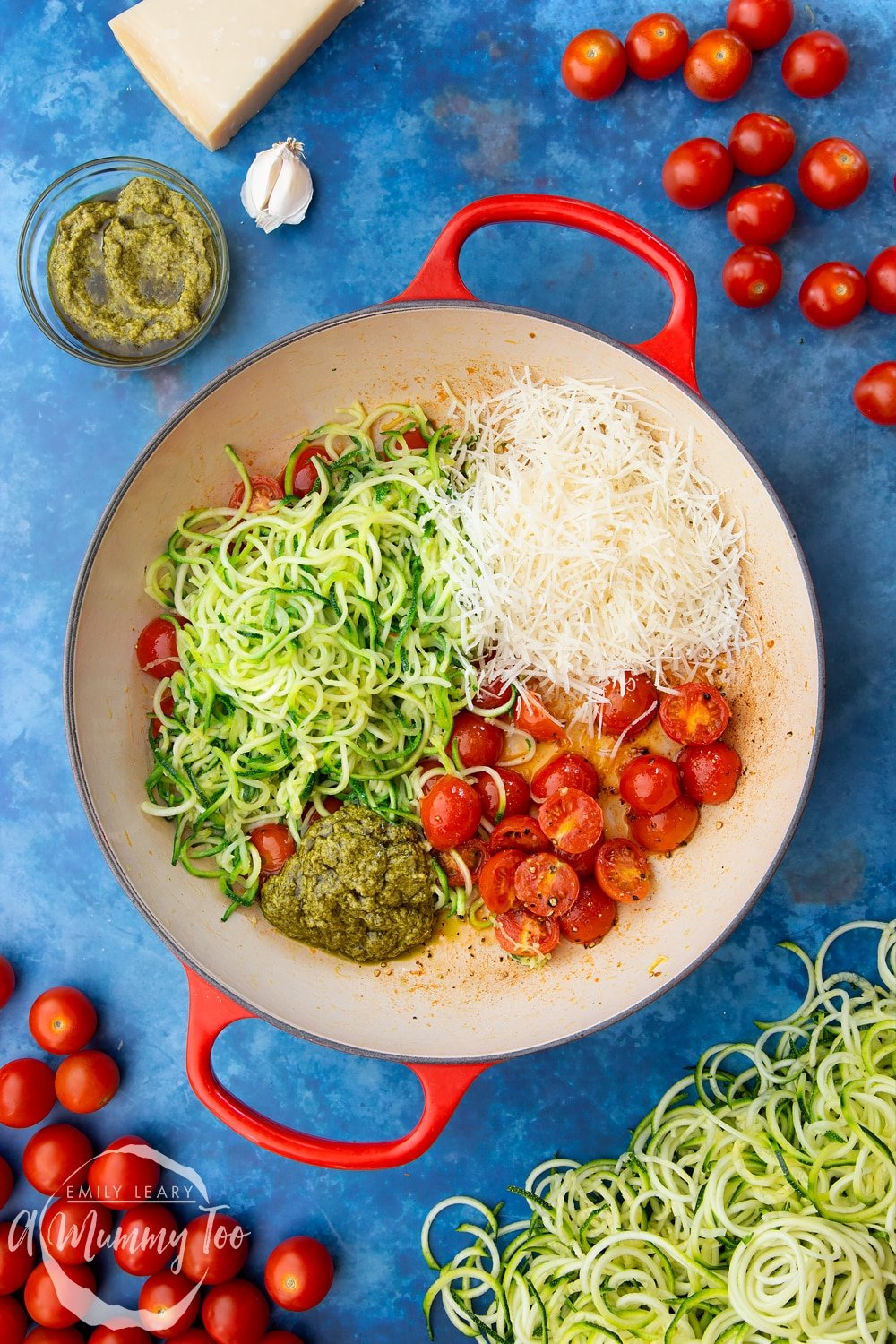 Cherry tomatoes, pesto, grated parmesan, garlic, olive oil, black pepper and spiralised courgette in a frying pan