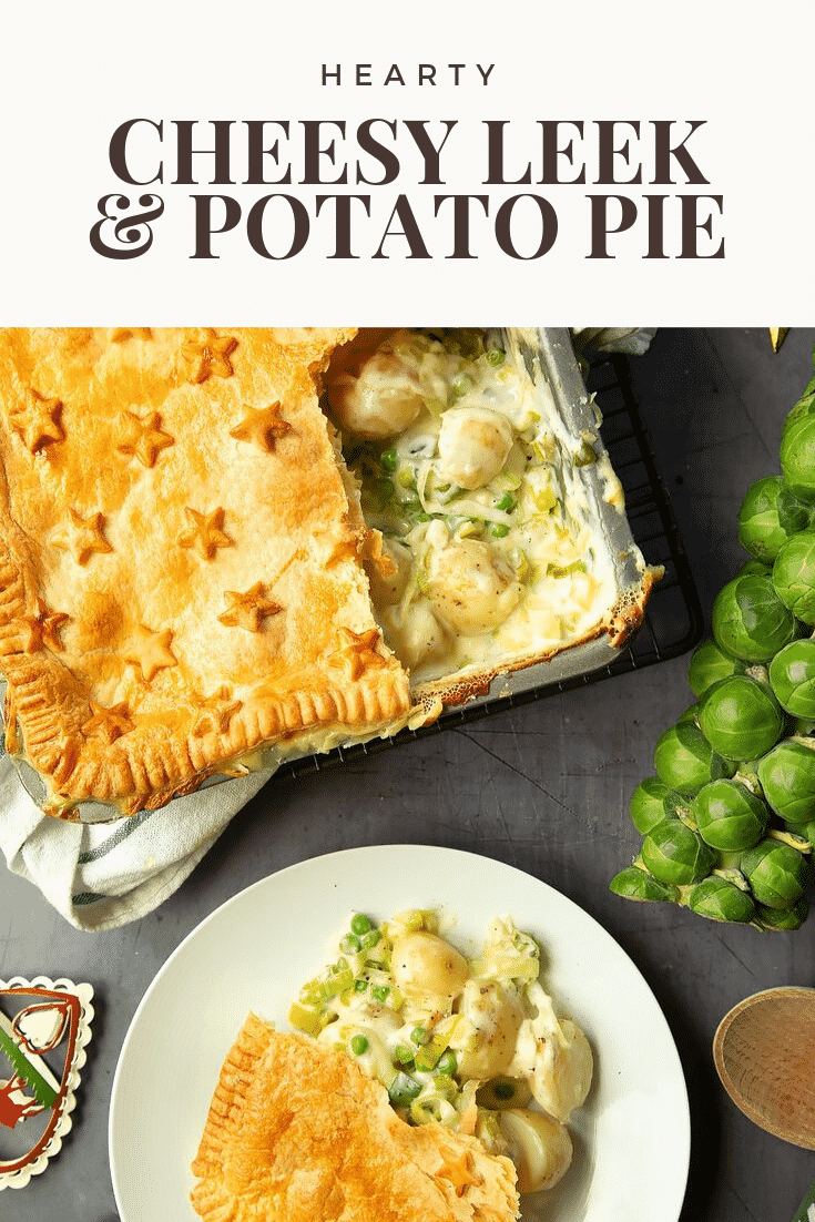 Overhead shot of the leek and potato pie. A slice has been cut from the tray and placed on a white plate. At the top of the image there is some text describing the image for Pinterest.