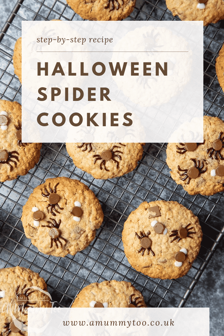Halloween peanut butter spider cookies resting on a cooling tray having just come out the oven.