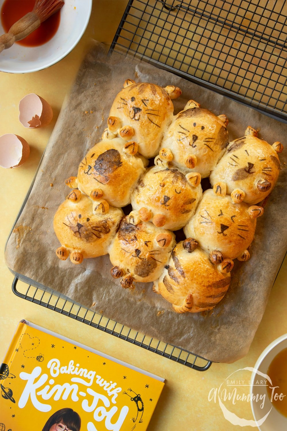 9 cat-shaped tangzhong bread roll, decorations complete, resting on a tray lined with baking paper.