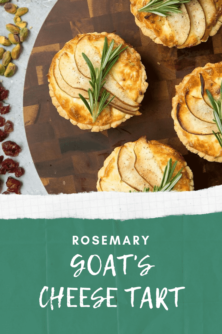 Overhead shot of three rosemary goats cheese darts on a dark wooden circular board with some nuts and rasins at the side. At the bottom of the image there's some white text on a teal background describing the image for Pinterest.