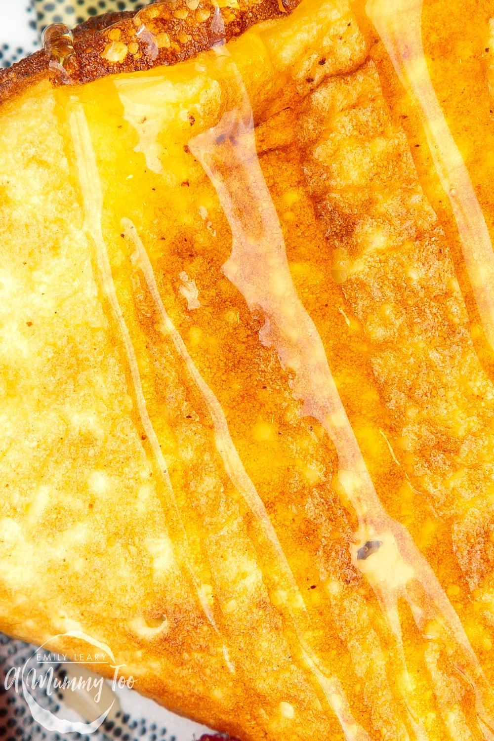 Sweet breakfast omelette, very close up to show the texture, drizzled with honey