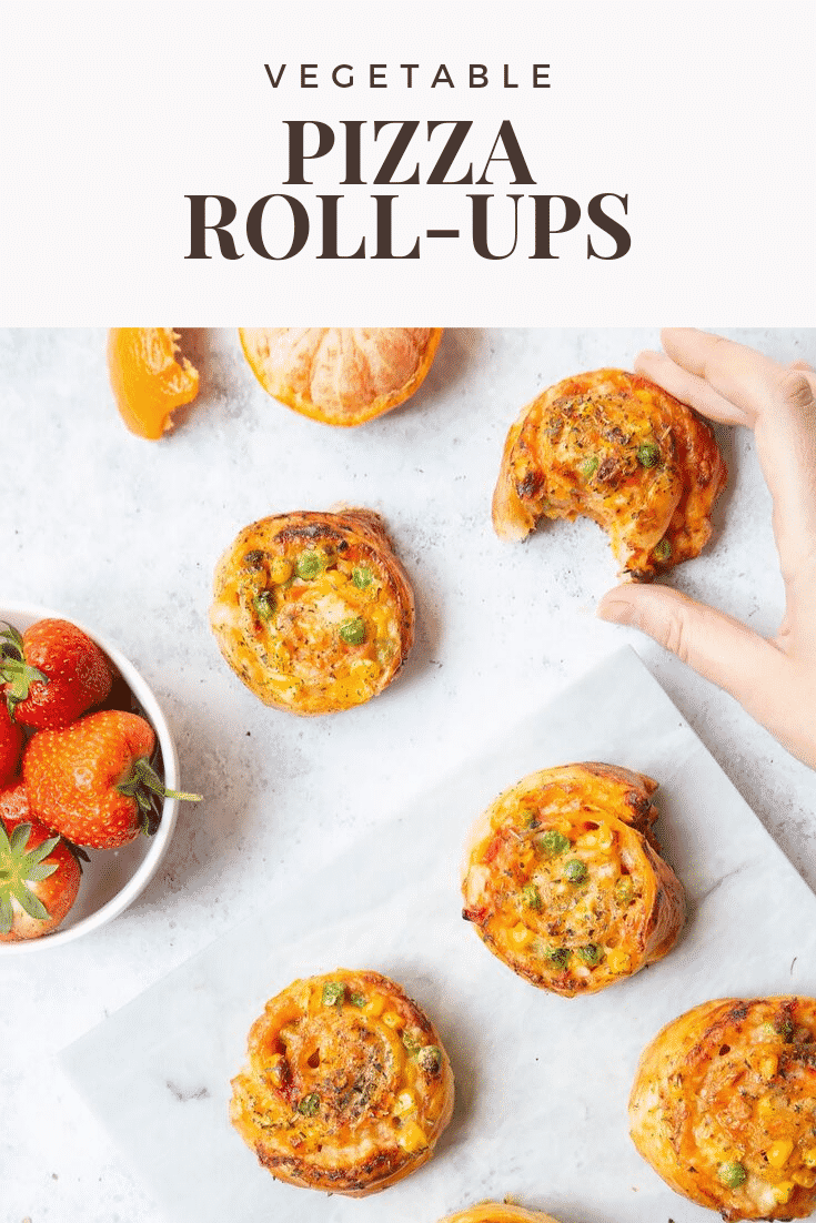 Five Veggie Pizza Roll Ups on a white tray, a hand is going in to pick one of them up. At the top of the image there's some text describing the image for Pinterest.