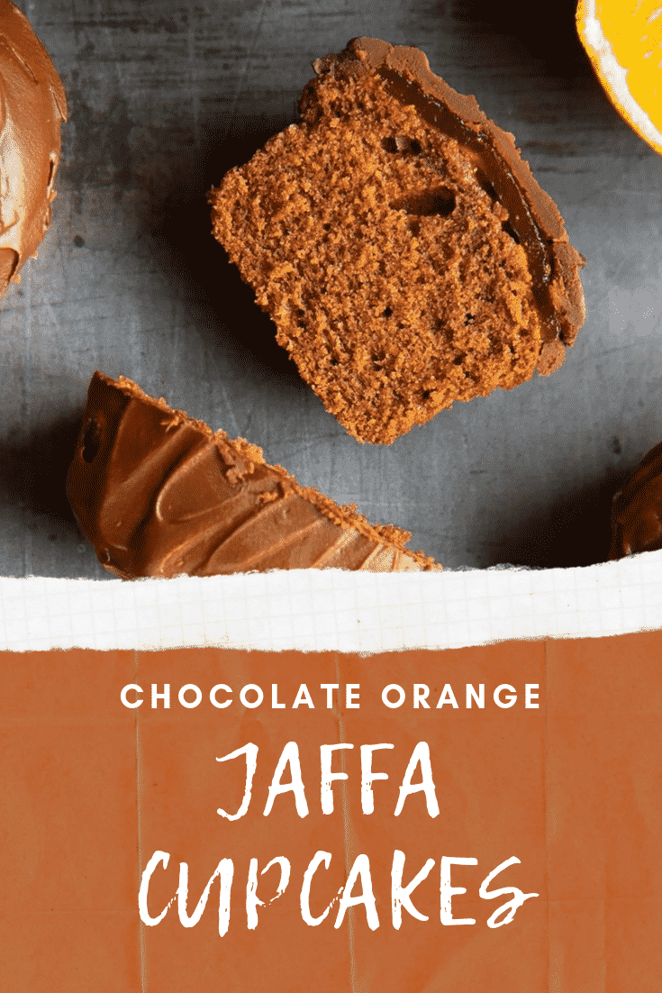 Close up shot of the inside of chocolate orange jaffa cupcakes. At the bottom of the image there's some white text on a brown background describing the image for Pinterest.