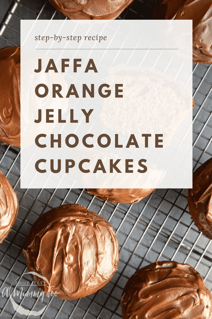 Overhead shot of multiple jaffa orange jelly chocolate cupcakes cooling on a wire rack. At the top of the image there's some brown text on a white background describing the image for Pinterest.