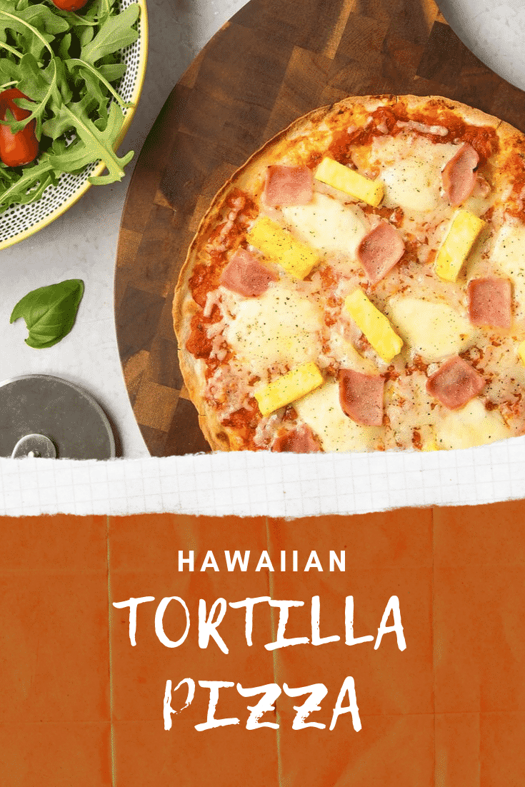 Overhead close up shot of the finished Hawaiian pizza on a wooden board with some salad on the side. At the bottom of the image there's some white text on. red background describing the image for Pinterest.