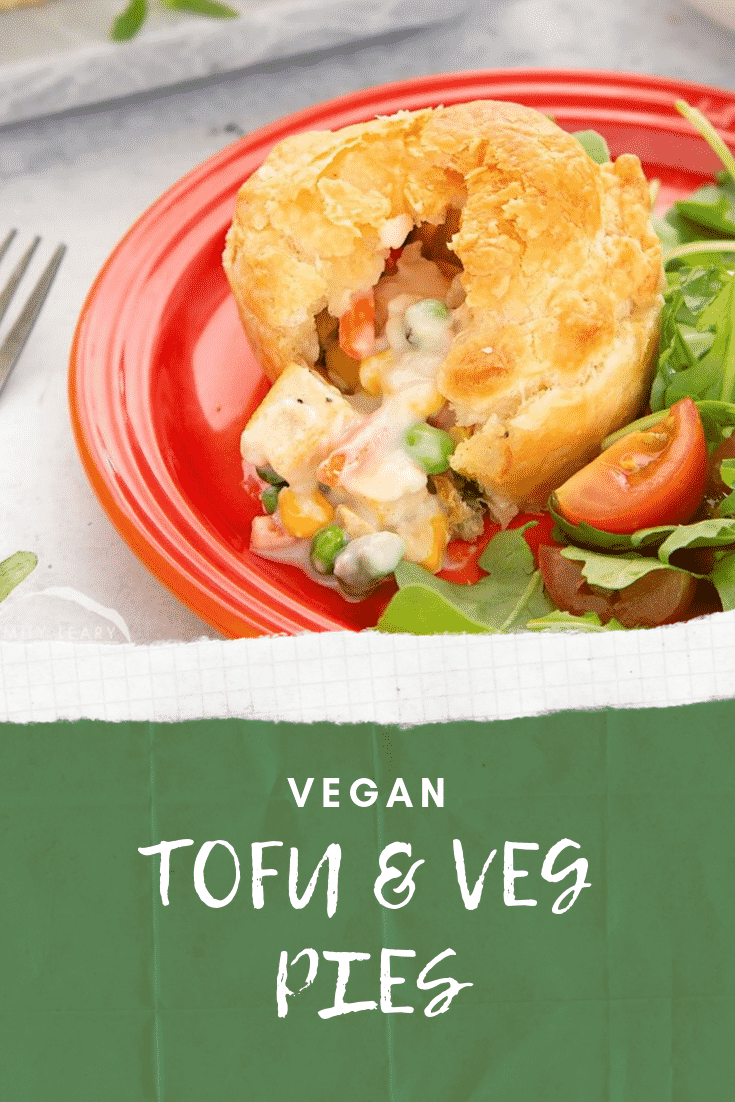 Close up side on view of the cut open vegan pie on a red plate with some salad on the side. At the bottom of the image there's some white text on a green background describing the image for Pinterest.