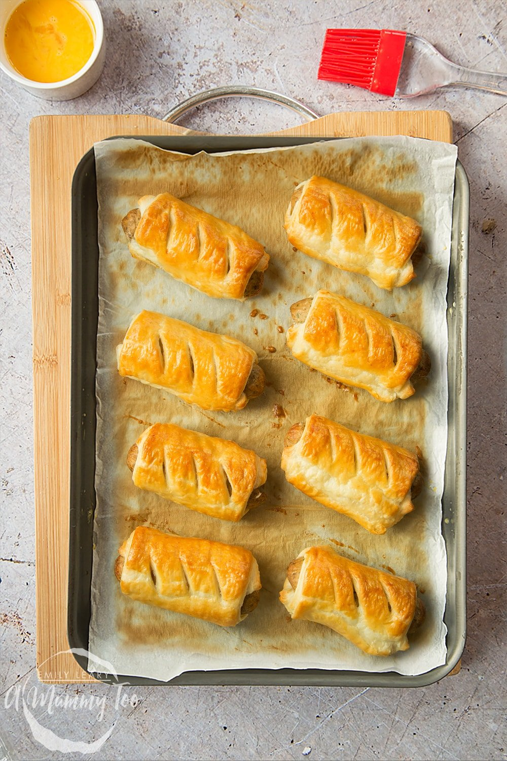 Vegetarian sausage rolls on a baking tray, freshly cooked.