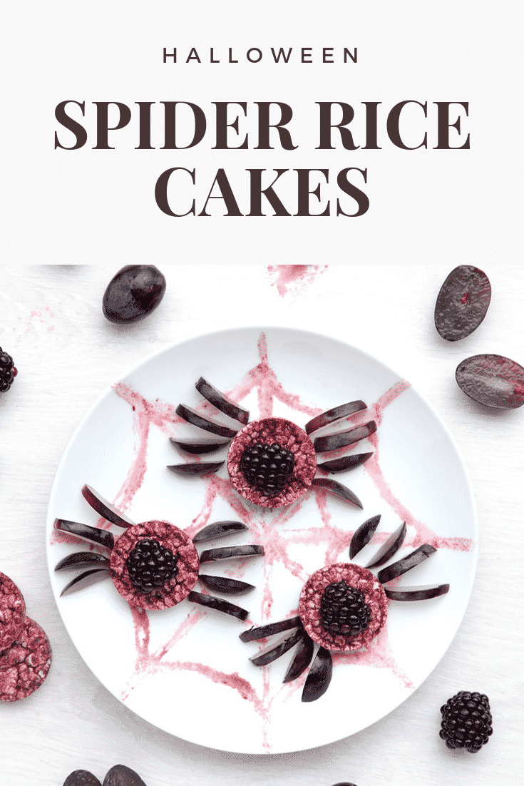 Halloween rice cakes, decorated with blackberries & grapes to look like spiders on a spider's web. Caption reads: Halloween spider rice cakes.