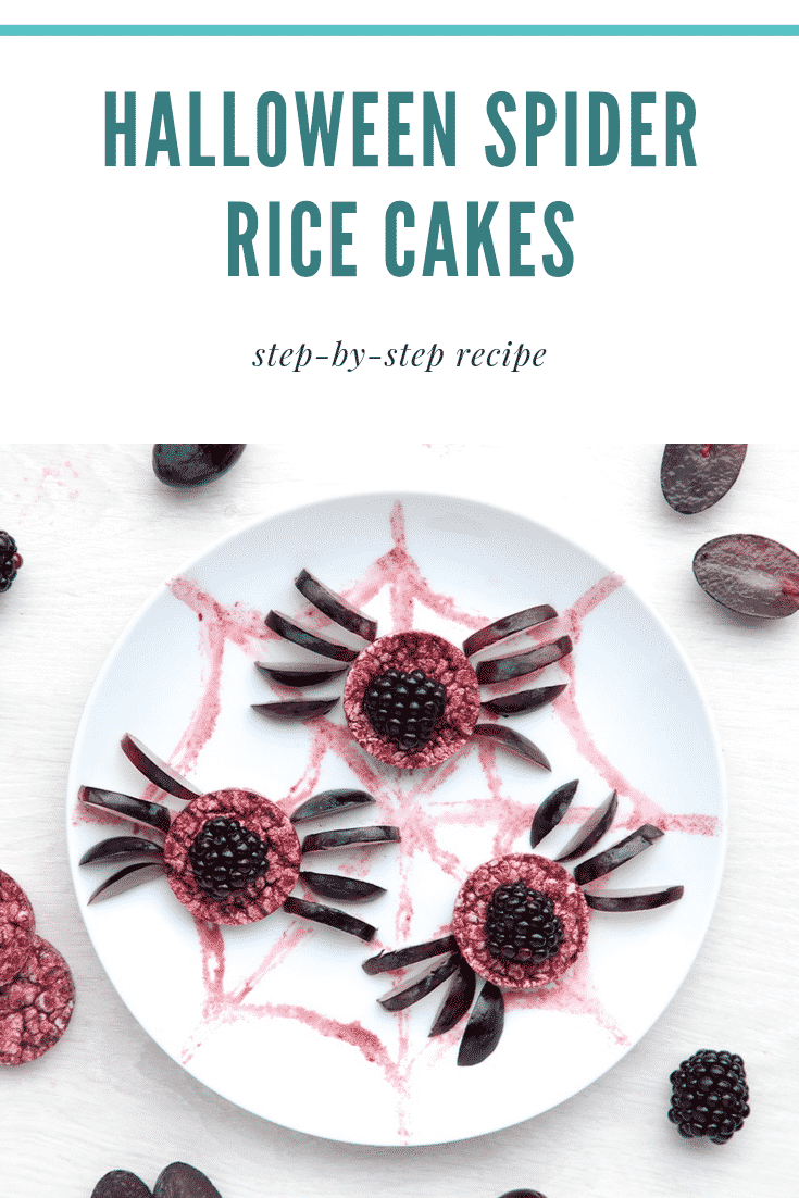 Halloween rice cakes, decorated with blackberries & grapes to look like spiders on a spider's web. Caption reads: Halloween spider rice cakes. Step-by-step recipe.