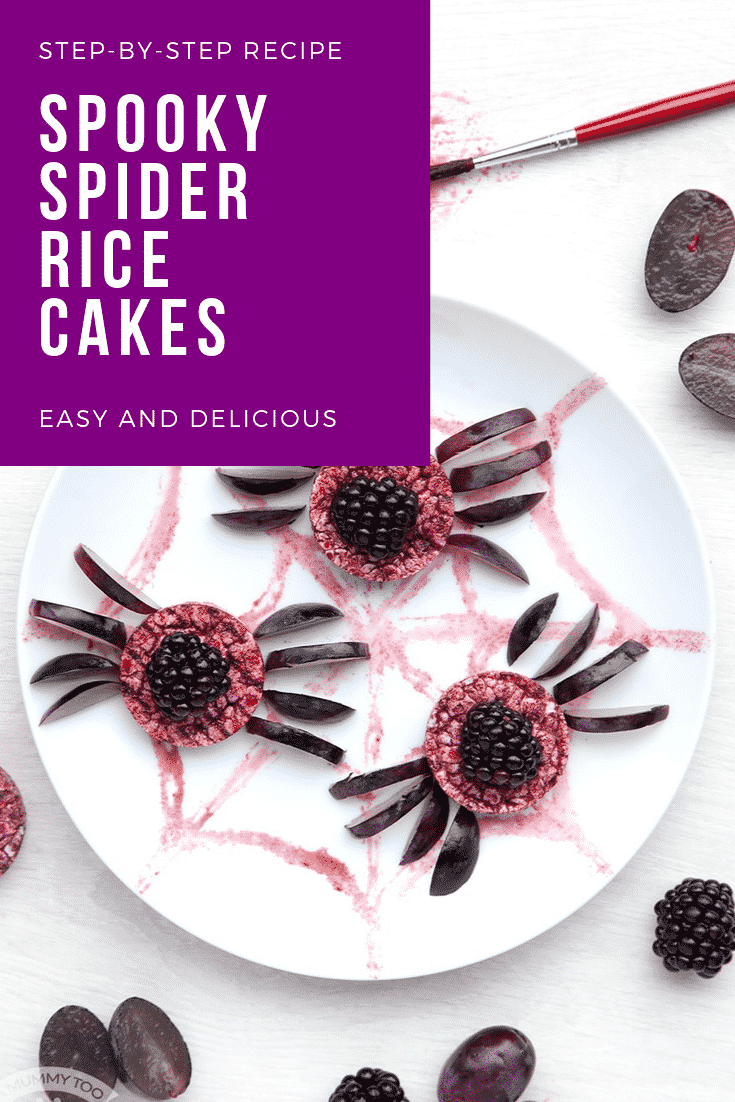 Halloween rice cakes, decorated with blackberries & grapes to look like spiders on a spider's web. Caption reads: Step-by-step recipe. Spooky Halloween spider rice cakes. Easy and delicious.