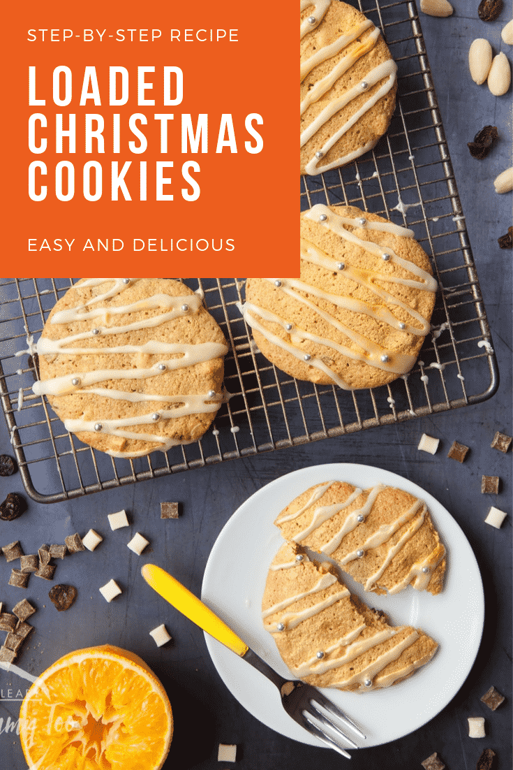 Overhead shot of loaded Christmas cookies on a cooling rack with some text at the top of the image describing it for Pinterest.