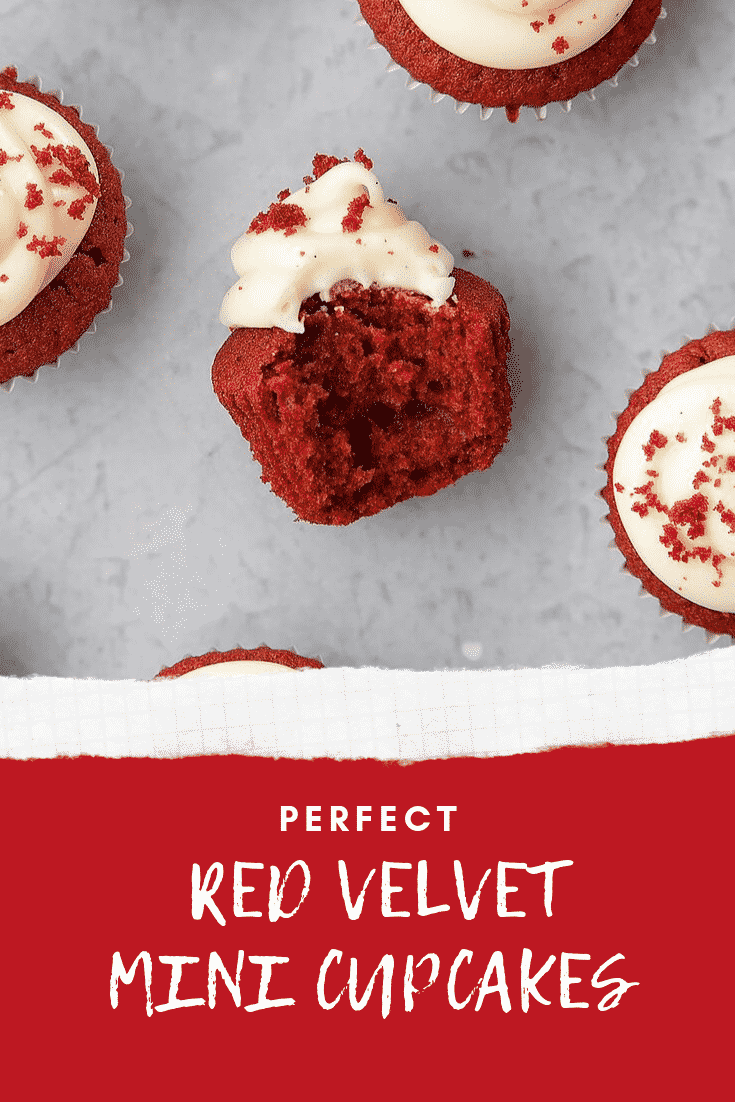 Sidewards overhead shot of a Mini red velvet cupcakes with cream cheese frosting on a grey table with white text describing the image for Pinterest at the bottom.