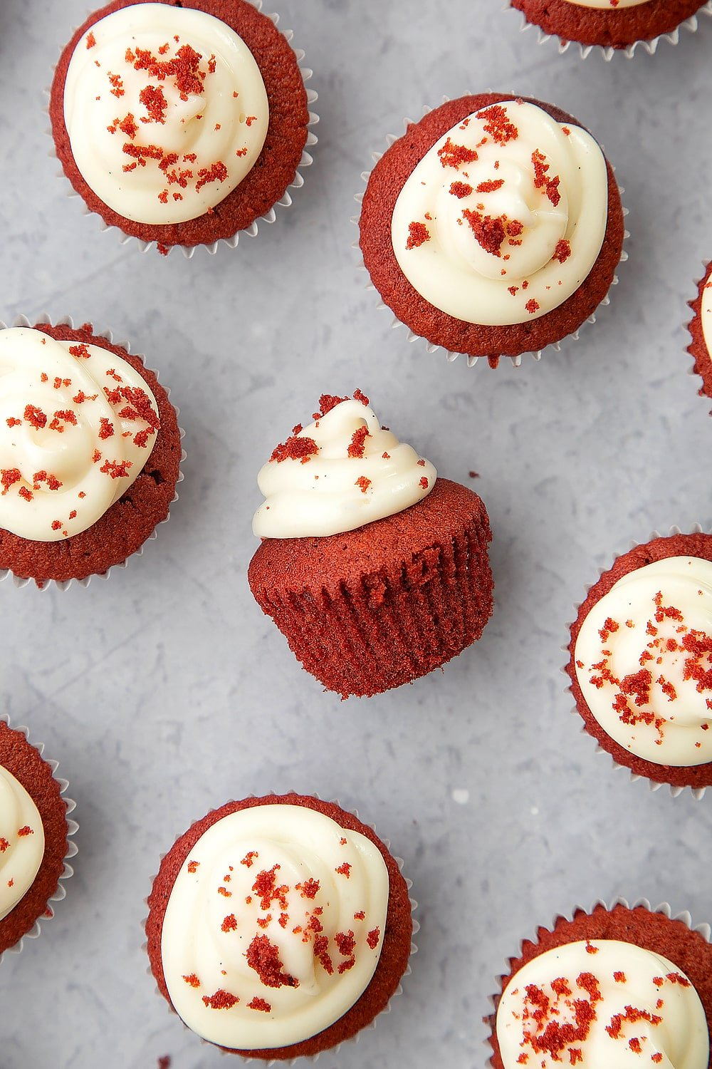 Overhead shot of mini red velvet cupcakes with cream cheese frosting.