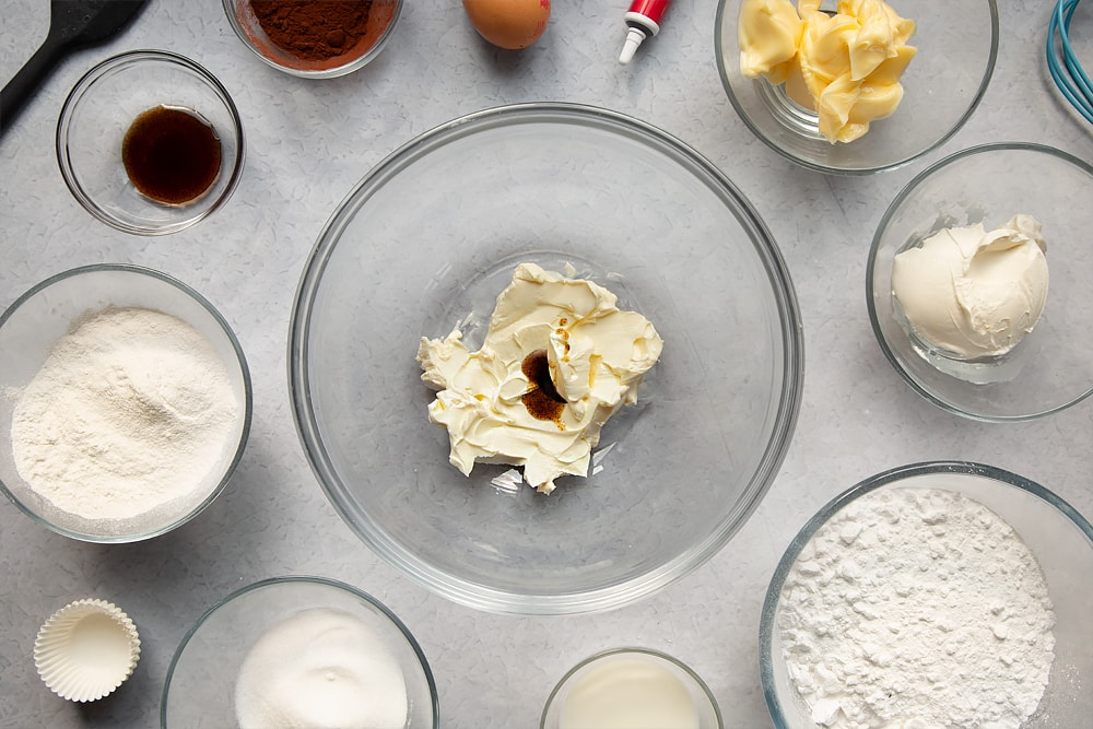 Overhead shot of mixing together ingredients for the cream cheese frosting.