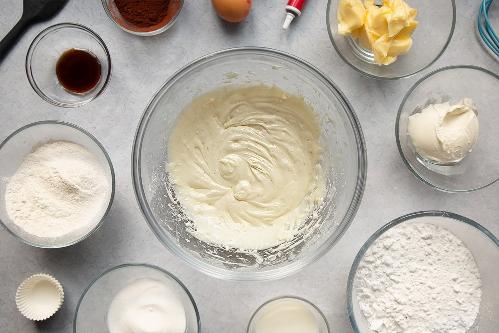 Cream cheese frosting having been mixed together in a bowl.