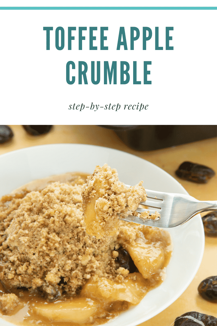 A fork taking out some of the toffee apple crumble. At the top there's some text describing the image for Pinterest