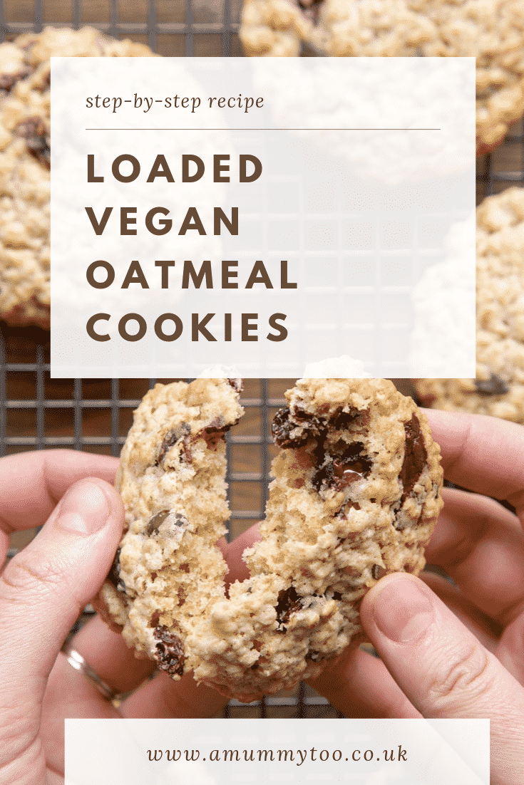 A hand holds a vegan oat cookie and is breaking it open. Caption reads: step-by-step recipe loaded vegan oatmeal cookies