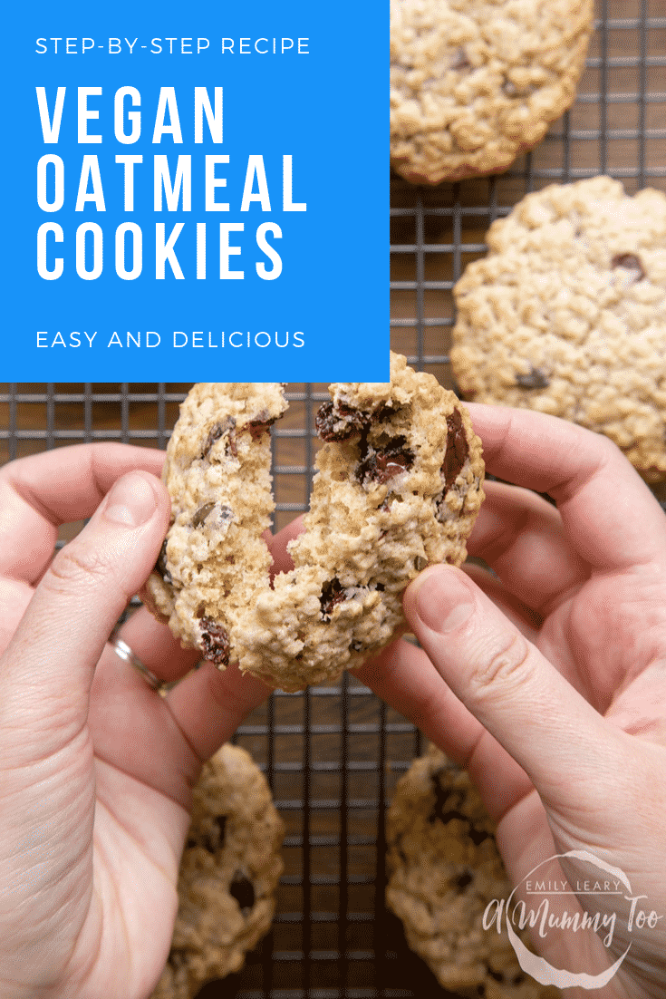 A hand holds a vegan oat cookie and is breaking it open. Caption reads: step-by-step recipe vegan oatmeal cookies easy and delicious