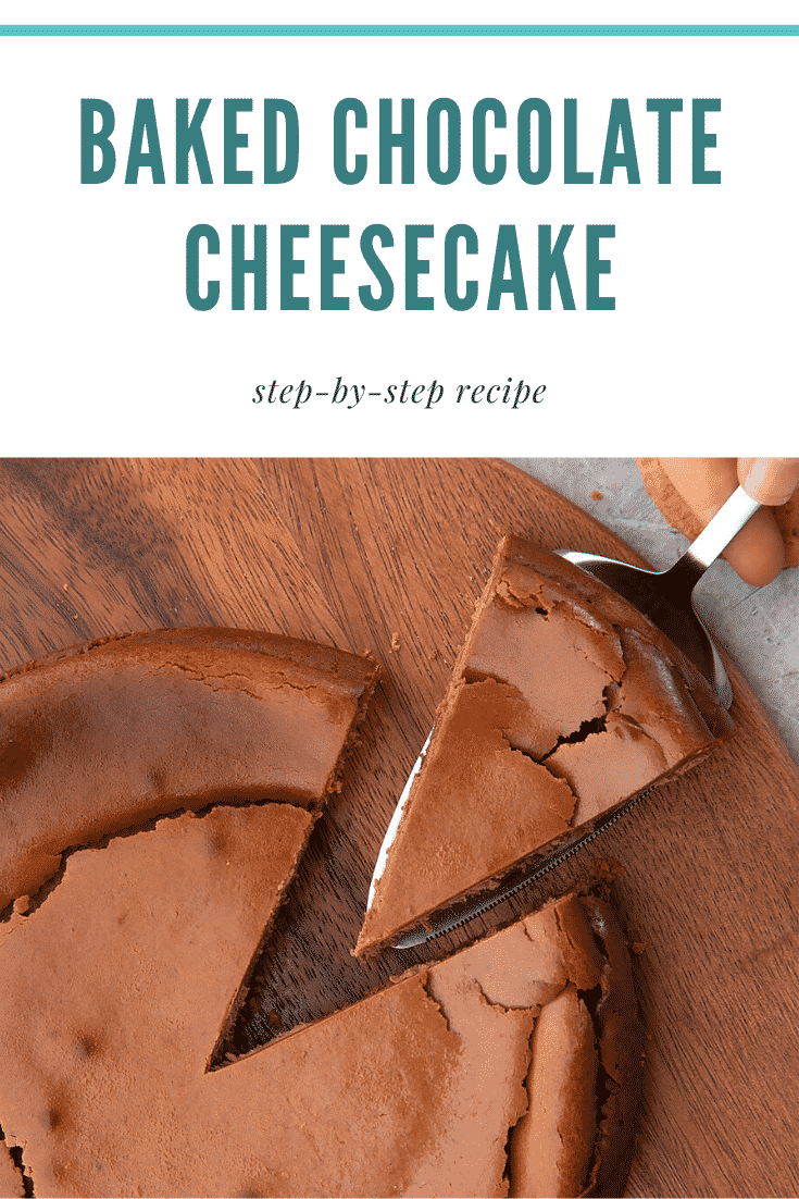 Overhead shot of the finished baked chocolate cheesecake on a wooden board. At the top of the image there's some text describing the image for Pinterest.