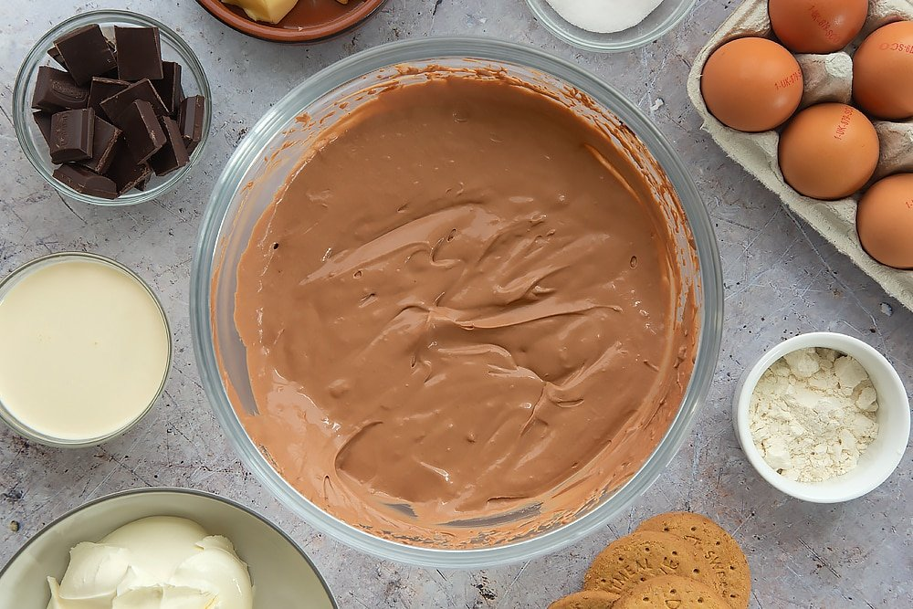 Overhead shot of the finished chocolate cheesecake mixture in a Pyrex bowl.