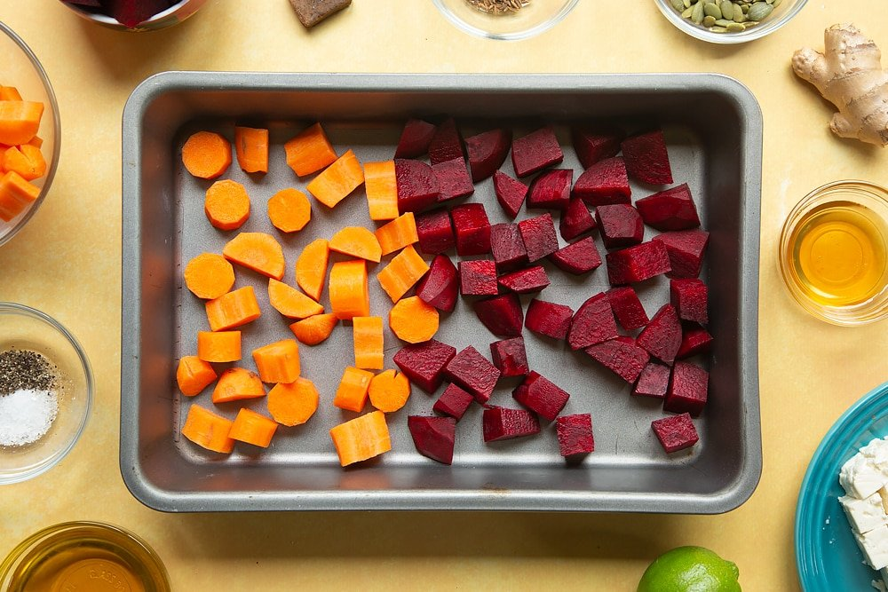 Overhead shot of the chopped beatroot and butternut squash in a pan.