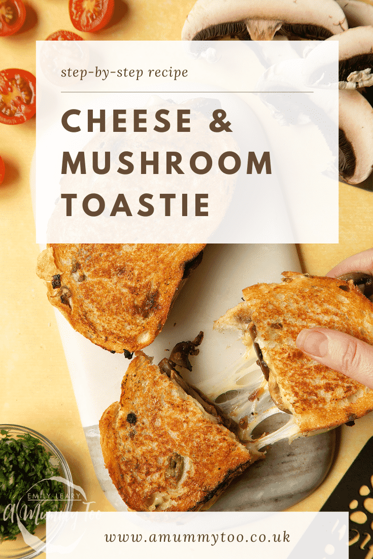Two Jarlsberg cheese and mushroom toasties are on a serving board, one is being pulled apart very wide, the cheese is stretching between them almost to the point of breaking.