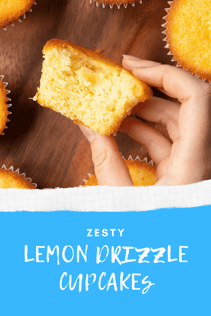 A hand holding a lemon drizzle cupcake above a dark wooden board. Caption reads: zesty lemon drizzle cupcakes