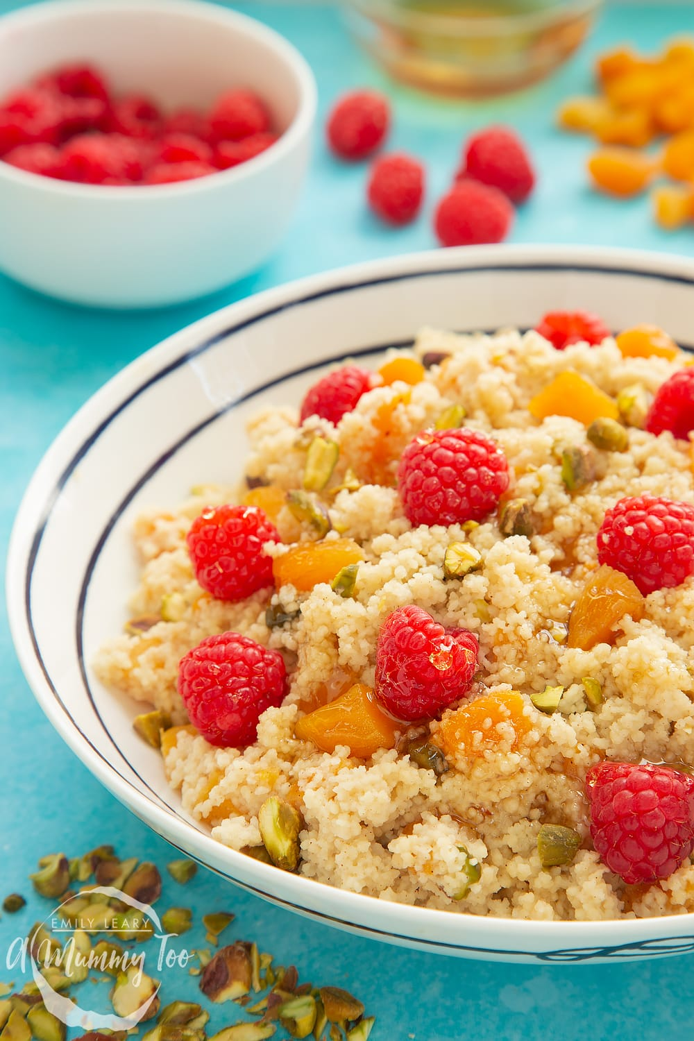 Close up shot of the sweet breakfast couscous. In the background you can see the dried apricots and the raspberries.