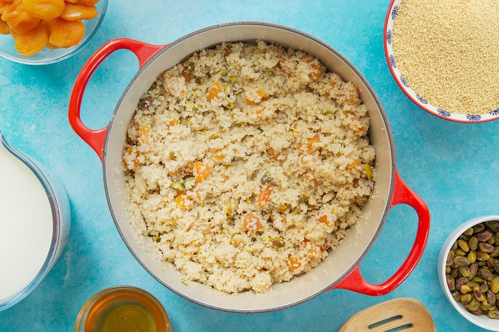 Stirring through the remaining ingredients just added to the sweet breakfast couscous.