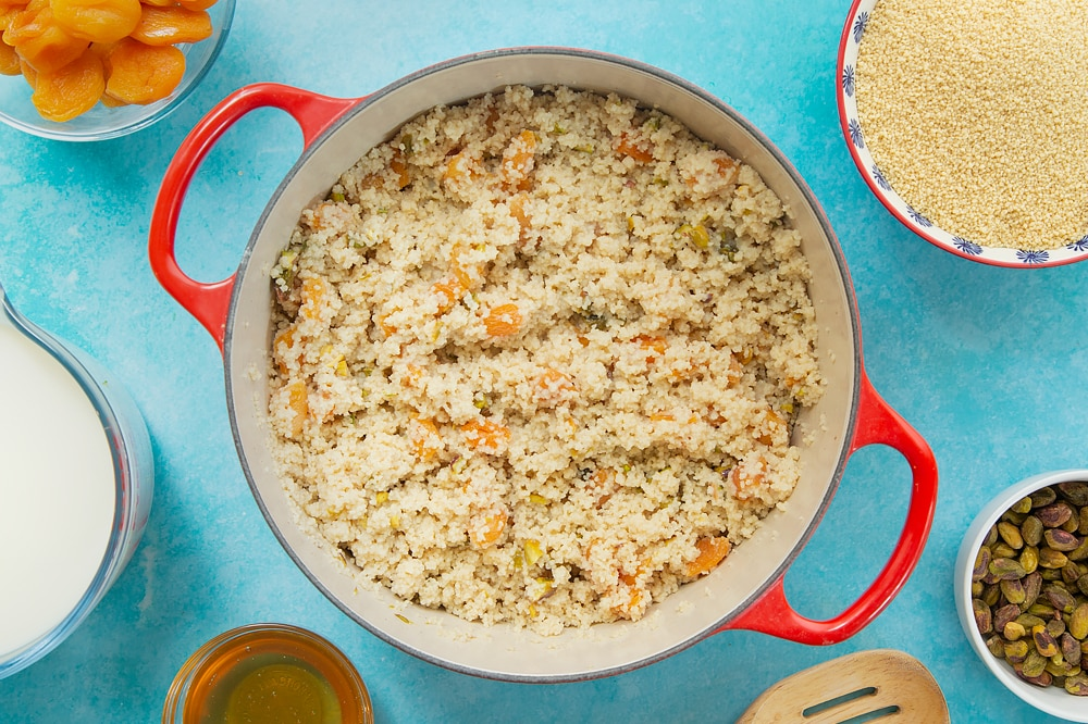 Finished sweet breakfast couscous in a large pan.