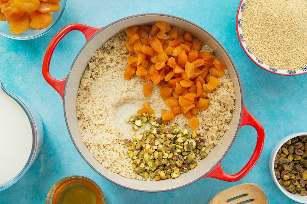 Adding the remaining ingredients to the pan of sweet breakfast couscous.