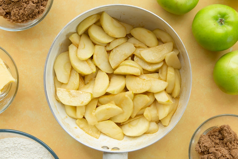 Overhead shot of the apples having been cooked in the pan for 5 minutes.