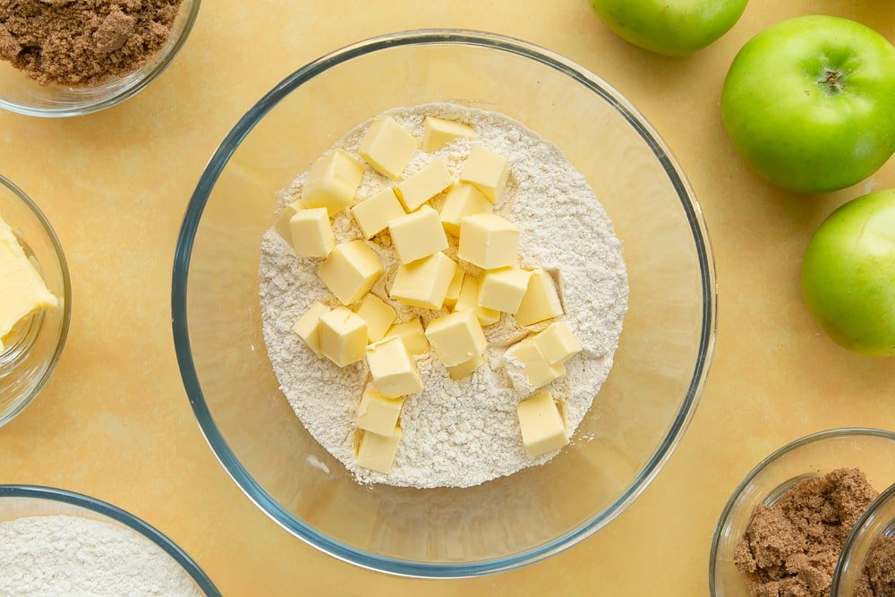 Overhead shot of the butter and flour in a bowl to make the topping for the toffee apple crumble.